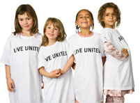Group of kids wearing Live United teeshirts