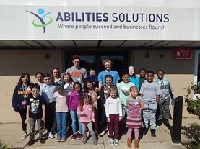 People standing under the Abilities Solutions
