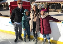 Group of People standing on ice rink