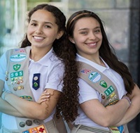 two girlscouts smiling