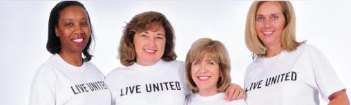 Women wearing Live United Tshirts